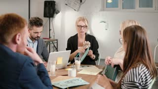 female leader reported bad news of company's development, everyone is upset. business team in a modern startup office.