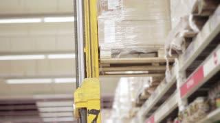 forklift trucks loads the goods in a supermarket