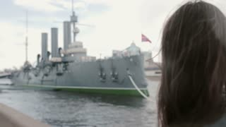 Girl taking photos of Cruiser Aurora St. Petersburg