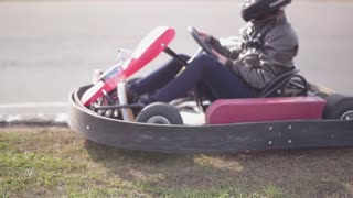 Go-kart track. Kart starts moving and slowly accelerates.