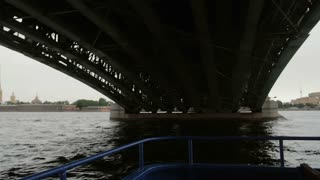 Going from underneath the Trinity Bridge, St Petersburg, Russia. City landscape, the Peter and Paul Fortress, slow mo
