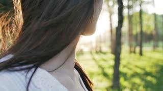 hair brunette girl develops wind at sunset
