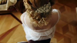 hair girl bride with curls and beautiful barrette
