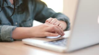 Hands teenage girl working on laptop in the room