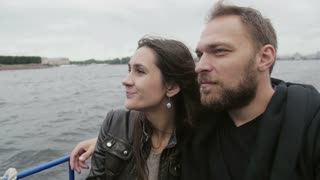 Happy beautiful couple admiring the city view. River tour in St Petersburg. Light goes off and on, sideview, slow mo