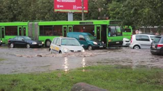 JULY 20 2016 MINSK, BELARUS Flood on a busy road in the city streets after rain with sound.