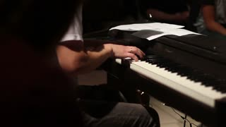 keyboard player playing on electric piano