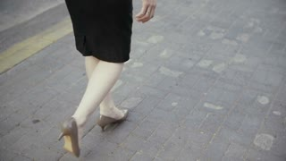 legs businesswoman walking in old city. slow mo