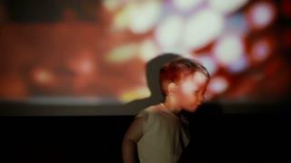 Little boy danceing in the spotlight