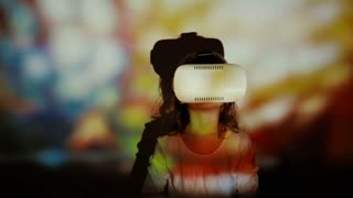 Little girl using 3D Virtual Reality headset