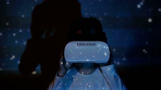 Little girl using augmented reality headset