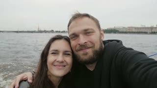 Love in St Petersburg. Caring couple, taking selfie, point-of-view shot. Happy couple in love, kissing, slow mo