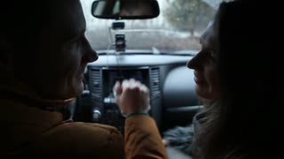 Man and woman in love lovingly look at each other and talk sitting in a car. Young couple spend time together.