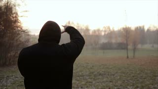 man makes workout at misty morning. slow motion