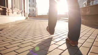 man walking on sidewalk. closeup foot
