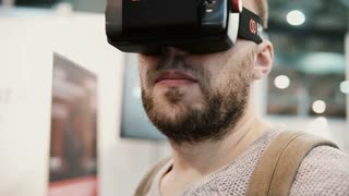 NOVEMBER 5, 2016 RUSSIA, MOSCOW Robotics Expo. Close-up bearded attractive man uses virtual reality glasses
