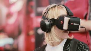NOVEMBER 5, 2016 RUSSIA, MOSCOW Robotics Expo. Close-up woman uses virtual reality glasses