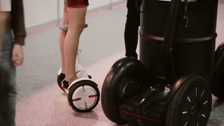 NOVEMBER 5, 2016 RUSSIA, MOSCOW Robotics Expo. Girl and boy s are riding Segway, electric balancing scooter board indoor
