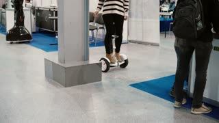 NOVEMBER 5, 2016 RUSSIA, MOSCOW Robotics Expo. Woman riding segway or electric balancing gyro scooter board at expo. 4K