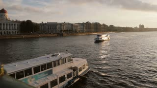 ST PETERSBURG, RUSSIA - 25 Sep 2016. River busses on river Neva in front of city architecture soft sunset light