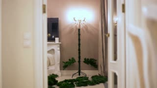 stop motion. Without people mounted an artificial Christmas tree, gradually appear balls, garlands, lights illumination.