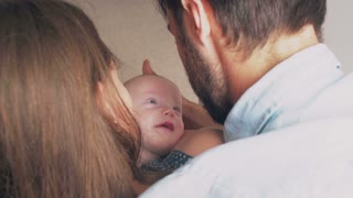 top view. Beautiful happy young parents smile to their precious newborn son. 4k
