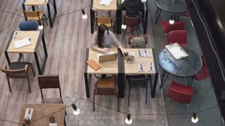 Top view. Businesswoman working on laptop in cafe 4k