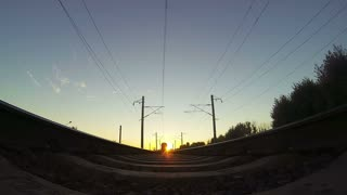 Train, view from below. Sunset