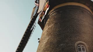 4K Close-up of traditional old rustic windmill. Netherlands. Dutch historical heritage. Tourism architecture landmark.