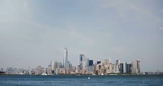 4K timelapse of New York financial district skyline. Manhattan Island panoramic view. Huge cruise liner boat passing by.