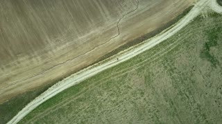 Aerial top view. Drone turning over the field. Beautiful countryside landscape of the empty meadow.