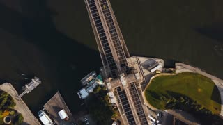 Aerial top view of Brooklyn bridge. Drone turning around the shore of East river in Brooklyn, New York, America.