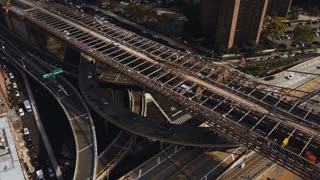 Aerial top view of traffic intersection in New York, America. Drone flying over the busy city roads, Manhattan district.