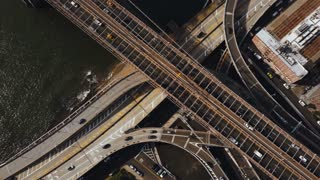 Aerial top view of traffic road in New York, America. Drone flying over traffic intersection on shore of East river.