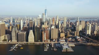 Aerial view of beautiful landscape of New York, America. Drone flying away from the Manhattan district on the shore.