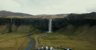 Aerial view of beautiful scenic landscape in Iceland. Powerful waterfall Seljalandsfoss falls down in mountains.