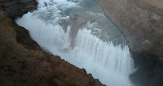 Aerial view of beautiful scenic landscape in Iceland, waterfall Gullfoss on the mountains. Turbulent flow.