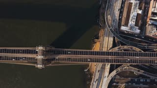 Aerial view of Brooklyn bridge through the East river from the Manhattan to Brooklyn in New York, America.