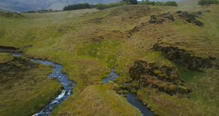 Aerial view of little river, stream became a powerful waterfall Gljufrabui in Iceland. Copter flying over turbulent flow