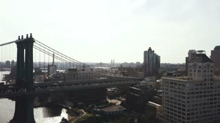 Aerial view of Manhattan bridge in Brooklyn district. Drone flying over the East river in New York, America.