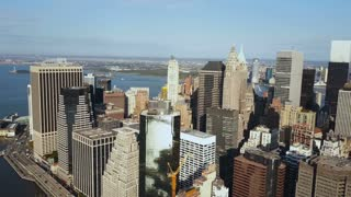 Aerial view of Manhattan downtown with office buindings in New York, America on the shore of East river in sunny day.