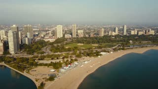 Aerial view of the beach on the shore of the lake Michigan. Drone flying over the Chicago, America on the dawn.