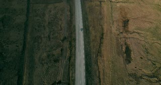 Aerial view of the beautiful landscape. Cars riding on the countryside road outside the city on the nature.
