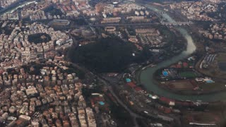 Aerial view of the beautiful panorama of Rome, Italy. Filming from the plane, famous capital from the air.
