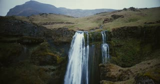 Aerial view of the beautiful waterfall Gljufrabui in Iceland. Copter flying near the famous sight, powerful stream.