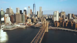 Aerial view of the Brooklyn bridge in New York, USA, going to the Manhattan district. American flag waving on the wind.