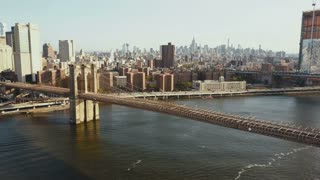 Aerial view of the Brooklyn bridge, Manhattan district in New York, America. Drone flying over the East river.