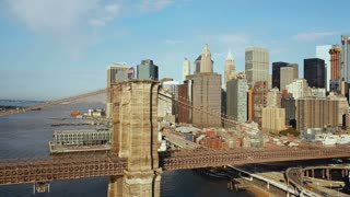 Aerial view of the Brooklyn bridge through East river to Manhattan in new York, America. Drone flying over the water.