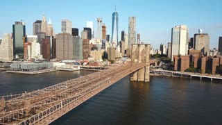 Aerial view of the Brooklyn bridge to Manhattan in New York, America through the East river in sunny day.