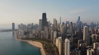 Aerial view of the Chicago, America. Busy downtown, city centre on the shore of the Michigan lake on the dawn.